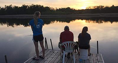 Teens fishing on dock